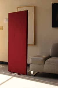 GIK Acoustics Freestand Free standing acoustic panels gobo next to couch