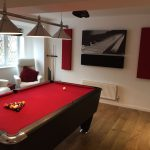 GIK Acoustics acoustic panels and acoustic art panel above billiard table in room