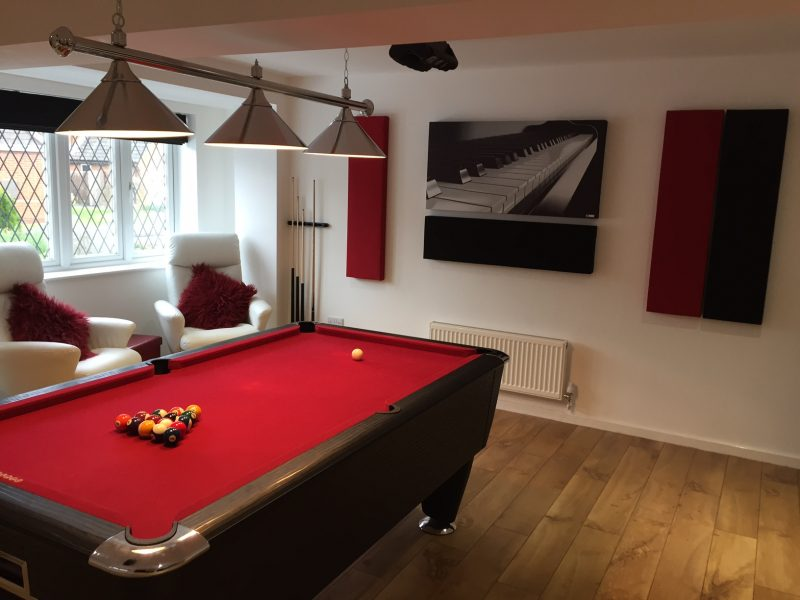GIK Acoustics acoustic panels and acoustic art panel above billiard table in room angled view