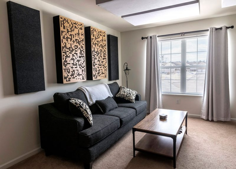 GIK Acoustics Alpha Series in room with couch and window