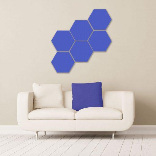 Gik acoustics hexagon acoustic panels small blue above couch